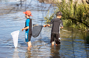kids fishing nets lake taupo
