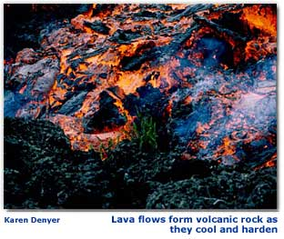 Photograph of molten lava with black cooling crust